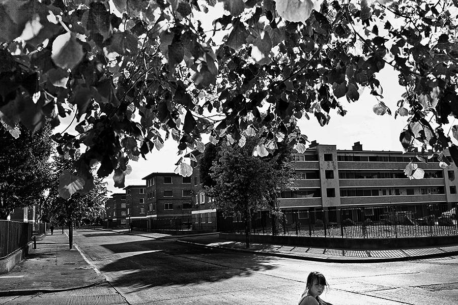 Girl walks through St.Teresas Gardens-estate-Dublin