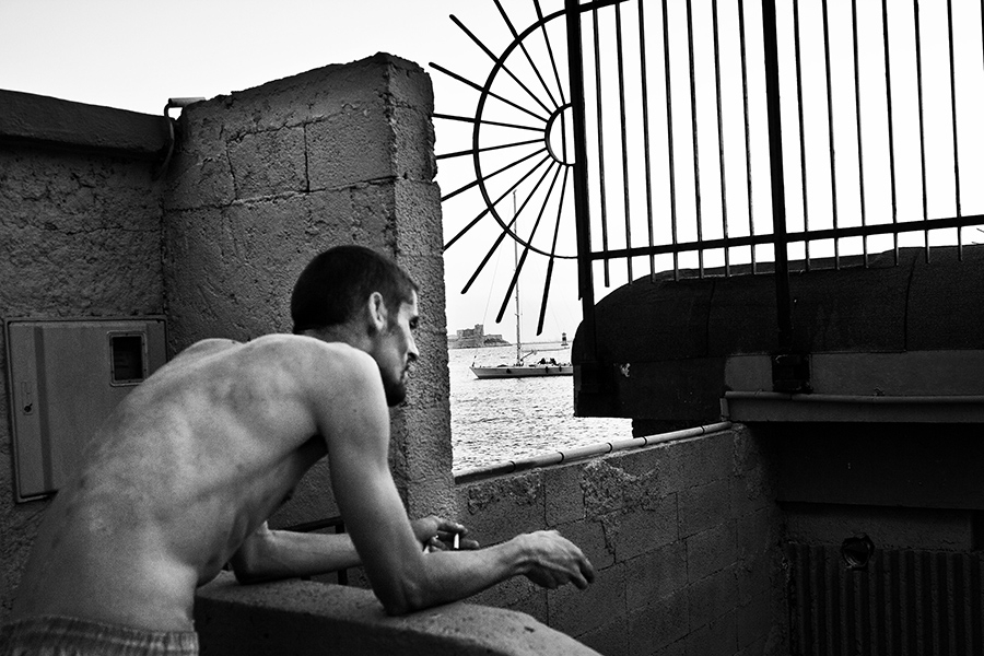 Man looks at the Mediterranean sea, Marseille