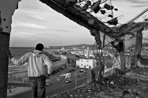 Would-be immigrant watches the port area to find out how the security system works, Tangier, Morocco