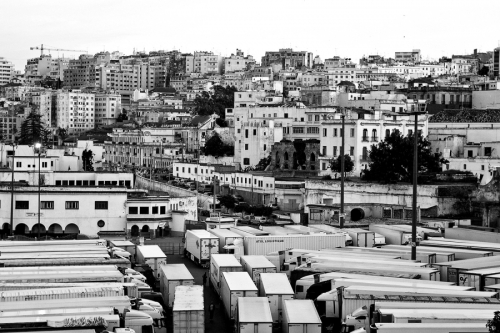 General view of the town and the trucks' parking area near the port. Tangier, Morocco
