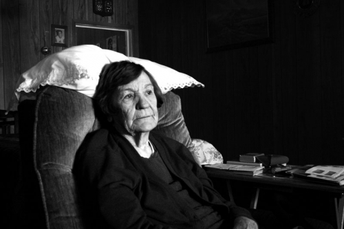 Older woman sitting in the chair