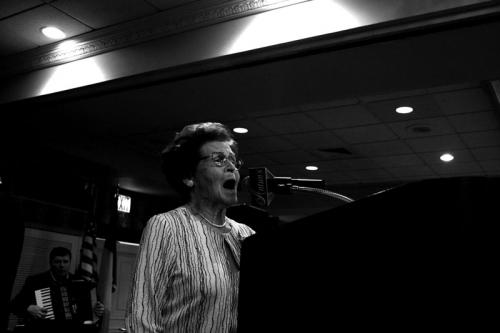 A lady singing the Irish National anthem