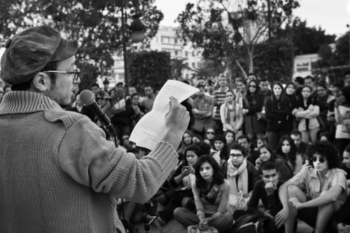 Poet Majd Mastoura performs at the Amnesty International meeting in Tunis