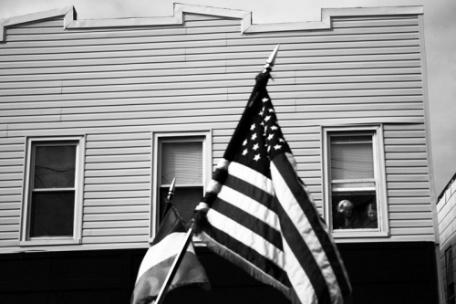 American flag in front of the house