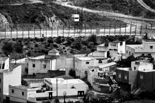 Border fence near Ceuta, view from Morocco