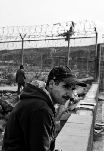 Men by the border fence near Ceuta, a Spanish enclave in Morocco
