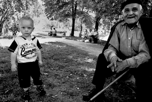 Boy with his grandfather at the park, Sarajevo