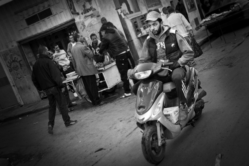 Man rides a scooter, Tunis