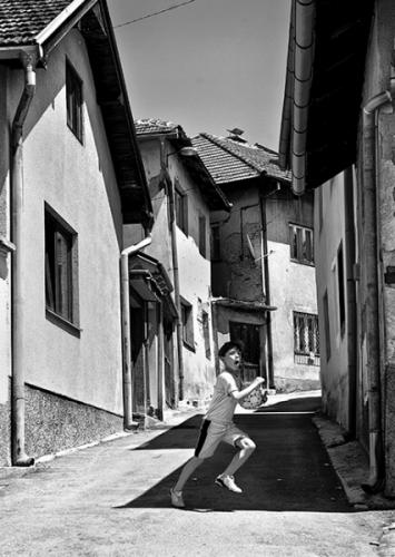 Boy runs on the street of Sarajevo