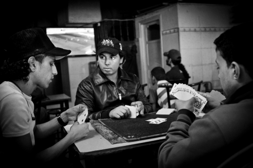 Teenagers play cards in Tunis café