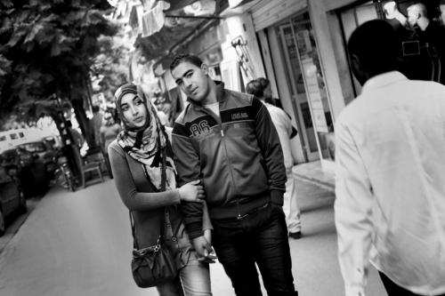 Couple walk the street of Tunis