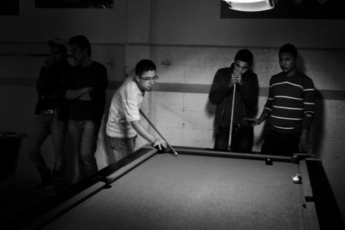 Young men play at the billard club, Kairouan
