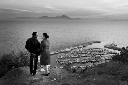 Couple stands at the seafront, Sidi Bou Said