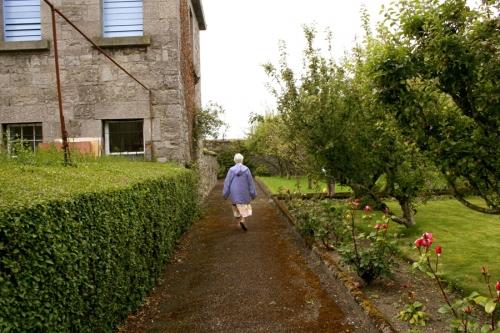 Sister walks through the convent garden
