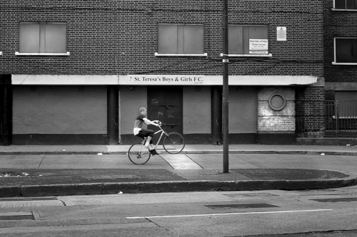 Teenager rides a bike at St. Teresas Gardens estate