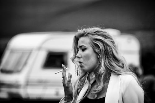 Traveller girl smokes a cigarette