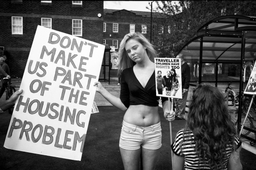 Traveller girl with a poster against evictions