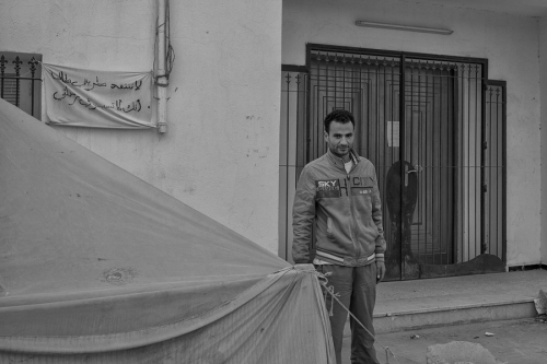 27. Zouhaier, 33, in front of the local government office, beside the tent used during sleepover protest