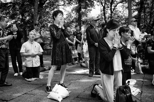 Chinese Christians praying at the park