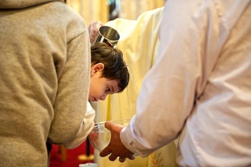 Boy is baptised in a church