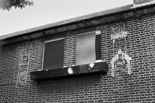 Christmas-decorations left on  disused building