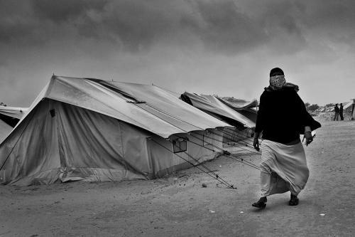 Woman walks through Choucha camp