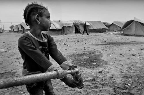 Girl washes her hands, Choucha refugee camp, Tunisia