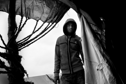 Refugee entering the tent, Choucha refugee camp, Tunisia