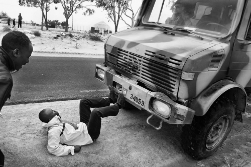 Refugee stops the military vehicle during the protest at the Choucha refugee camp,Tunisia