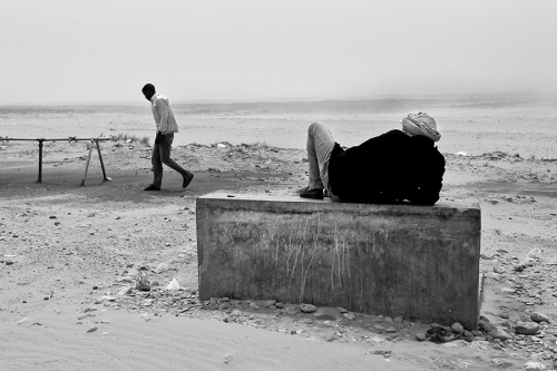 Man walks through outskirts of Choucha refugee camp,Tunisia