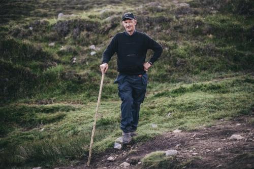 Croagh Patrick pilgrim, portrait of a male pilgrim with a walking stick