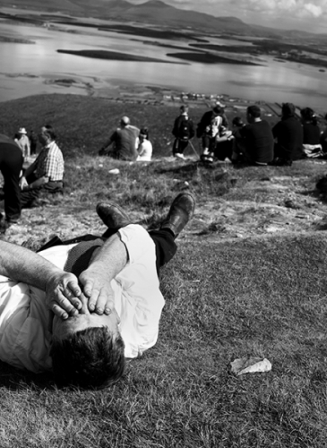 Croagh Patrick pilgrim has a rest at the slope of the mountain