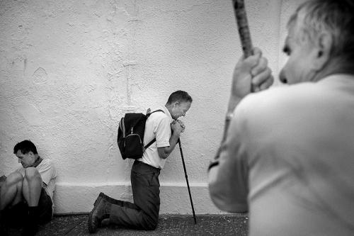 Croagh Patrick pilgrim kneeling