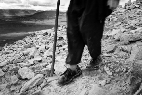 Croagh Patrick pilgrim descents the mountain with a walking stick