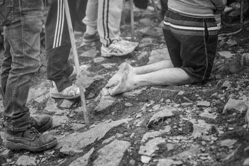 kneeling man Croagh Patrick pilgrimage