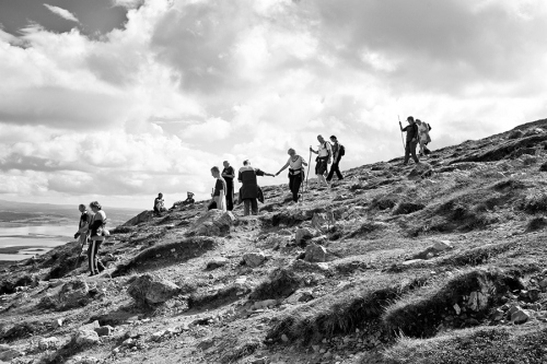 People help each other during Croagh Patrick pilgrimage