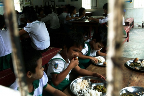 Children eat a meal in Yeik Mon orphanage. Mandalay, Myanmar