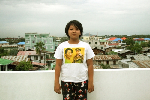 Young girl  wears a t-shirt with two of her idols, Aung San Suu Kyi and her father Aung San.