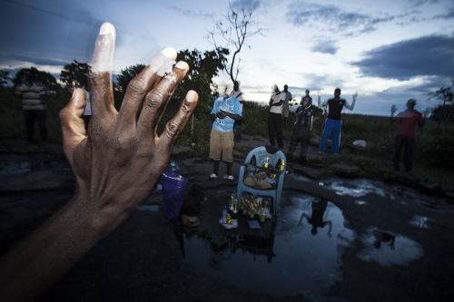 A group of Africans pray