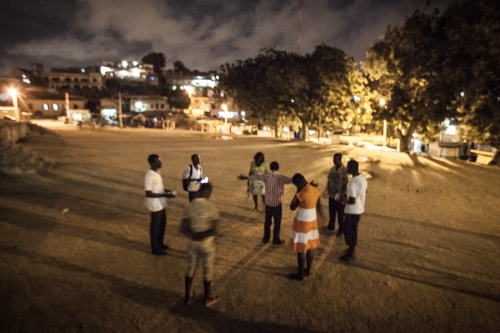 Young Africans pray at night
