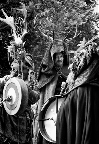 Man with a deer antlers on his head during the neopagans gathering
