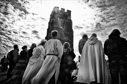 Neopagans gathering with a church in the background