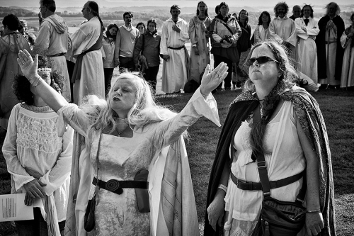 A woman prays at the neopagans gathering in the UK